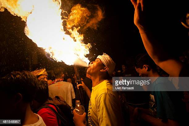 Hindu devotee breath a fire during the OgohOgoh festival parade on March 30 2014 in Yogyakarta Indonesia Balinese Hindus hold a Ogohogoh parade...