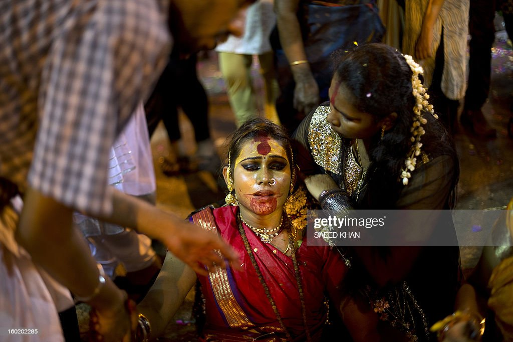 A Hindu devotee collapses after climbing a steep flight of 272 steps of Batu Caves and carrying milk pots for the offering during the Thaipusam Festival on the outskirts of Kuala Lumpur on January 28, 2013. The Hindu festival of Thaipusam, which commemorates the day when Goddess Pavarthi gave her son Lord Muruga an invincible lance with which he destroyed evil demons, is celebrated by some two million ethnic Indians in Malaysia and Singapore. AFP PHOTO / Saeed KHAN