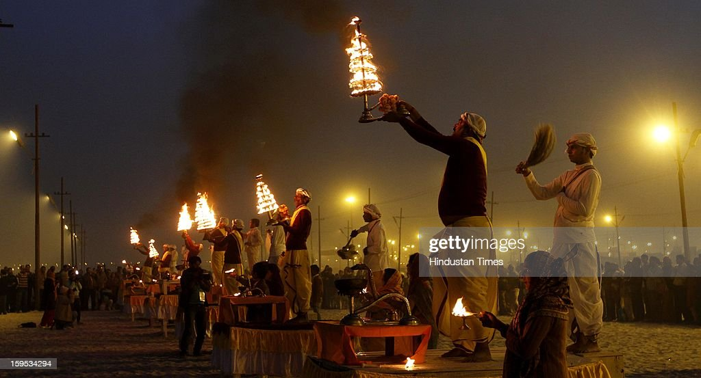 Hindu devotee doing Ganga Aarti at eveing on the bank of Sangam confluence of river Ganga, Yamnuna and mythical Saraswati on the occasion of Makar Sankranti on January 15, 2013 in Allahabad, India. Kumbh is World's biggest religious gathering, in which more than 100 million of Hindus and sikh devotees will take part over next 55 days. Apart from being pilgrimage of faith, salvation and hope for millions of devotees, it also serve as meeting ground for the vast spectrum of Indian religious and spiritual views.