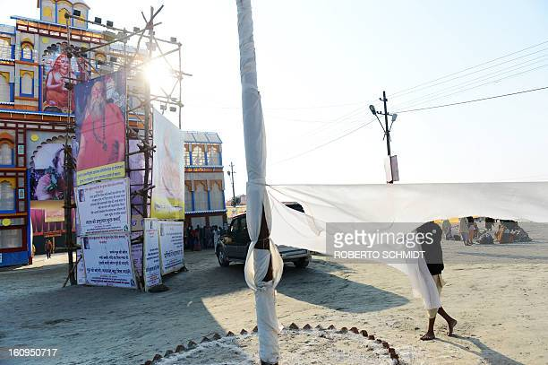 A Hindu devotee dries his dhoti near the entrance to one of hundreds of camps set up by different religious Hindu groups during the Maha Kumbh Mela...
