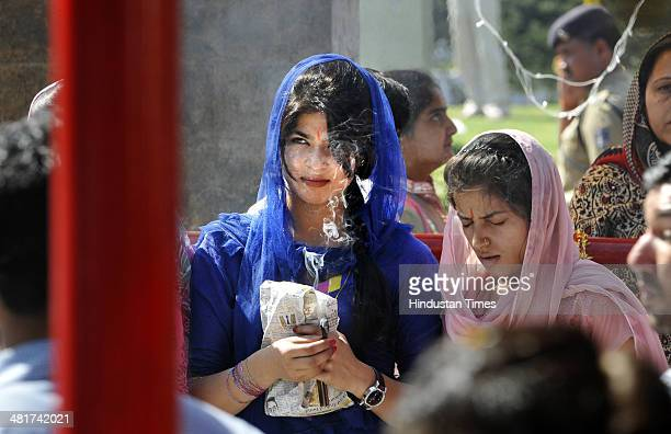 Hindu devotee offer prayers at a Kali Temple on the first day of the Navratra or nine nights festival on March 31 2014 in Jammu India Navaratri is a...