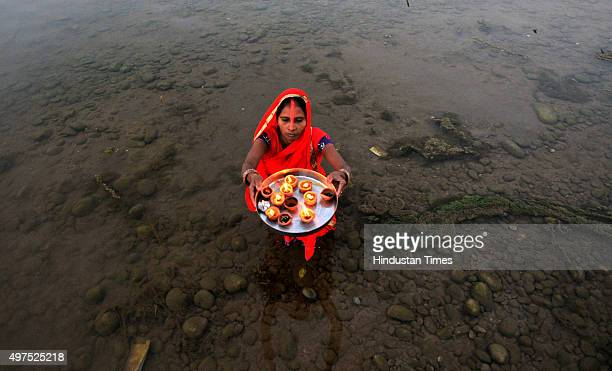 Hindu devotee offers prayers during the Chhath festival on November 17 2015 in Jammu India Chhath festival also known as Surya Pooja is observed in...