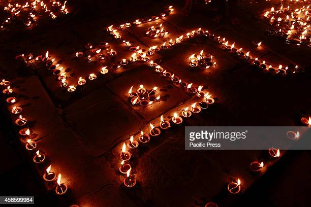 Hindu devotee offers the oil lighted lamps called 'Deepdan' to Ganga on Dev Deepavali or the light festival of the Gods that falls on the full moon...