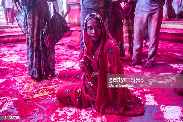Hindu devotee prays after having played with color at the Ladli Ji temple during Lathmaar Holi celebrations on March 21 2013 in the village of...