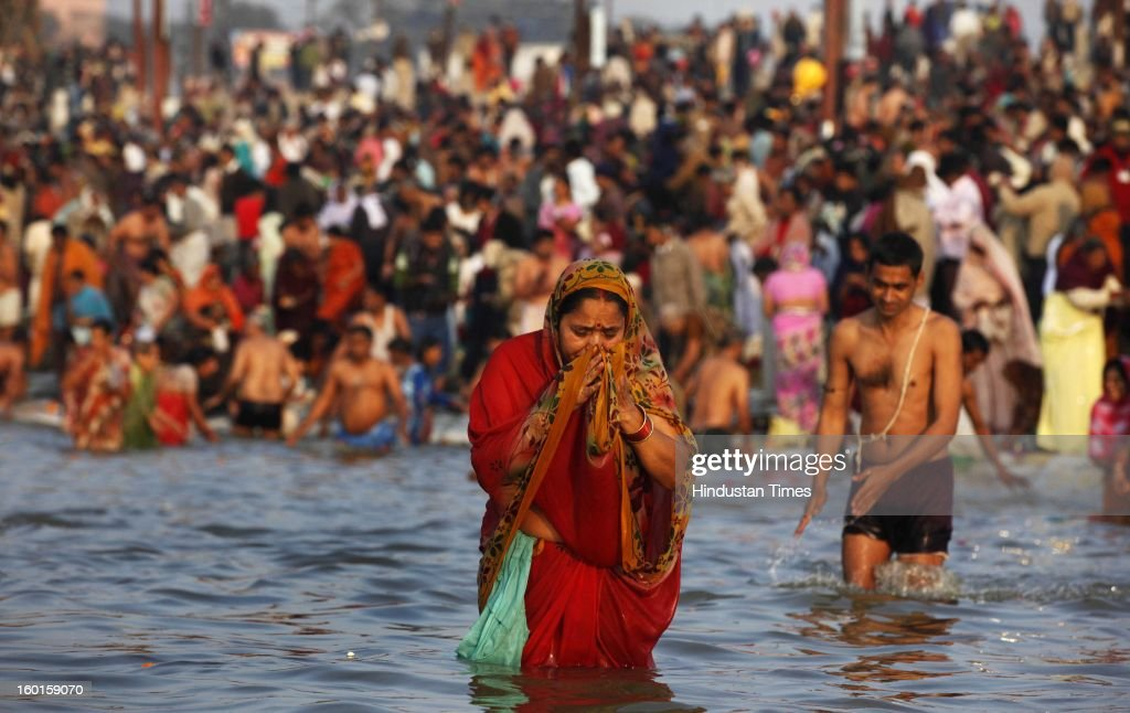 A hindu devotee takes dip at the Sangam, confluence of rivers Ganga, Yamuna and mythical Saraswati on the occasion of Paush Purnima on January 27, 2013 in Allahabad, India. Millions of Hindu pilgrims are expected to take part in the large religious congregation of a period of over a month on the banks of Sangam during the Maha Kumbh Mela in January 2013, which falls every 12th year.