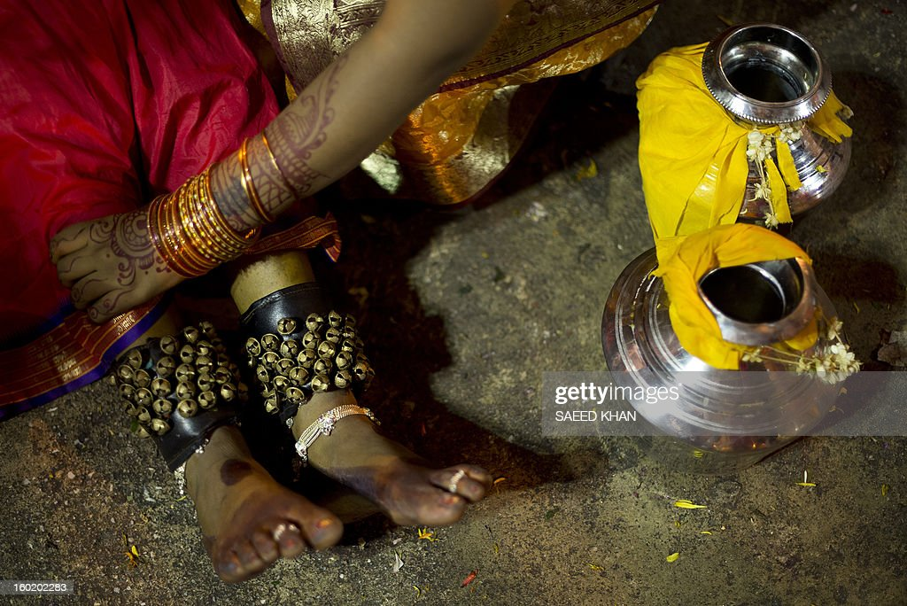 A Hindu devotee who collapsed after climbing a steep flight of 272 steps of Batu Caves and carrying milk pots for the offering is assisted during the Thaipusam Festival on the outskirts of Kuala Lumpur on January 28, 2013. The Hindu festival of Thaipusam, which commemorates the day when Goddess Pavarthi gave her son Lord Muruga an invincible lance with which he destroyed evil demons, is celebrated by some two million ethnic Indians in Malaysia and Singapore. AFP PHOTO / Saeed KHAN
