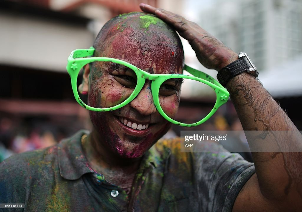A Hindu devotee with big glasses is covered in coloured powders as he celebrates 'Holi' at a temple in Kuala Lumpur on March 31, 2013. Holi, the festival of colours where people smear each other with coloured powder and water, is celebrated by Hindus across the country.
