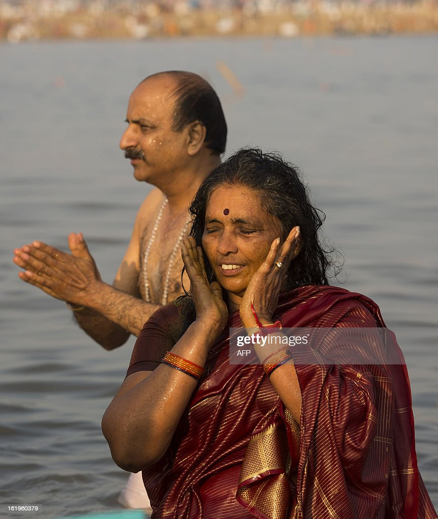 Hindu devotees bathe in the Sangam, the confluence of the Yamuna, Ganges and mythical Saraswati rivers during the Kumbh Mela in Allahabad on February 18, 2013. The Kumbh Mela in the town of Allahabad will see up to 100 million worshippers gather over 55 days to take a ritual bath in the holy waters, believed to cleanse sins and bestow blessings. AFP PHOTO/ Andrew Caballero-Reynolds