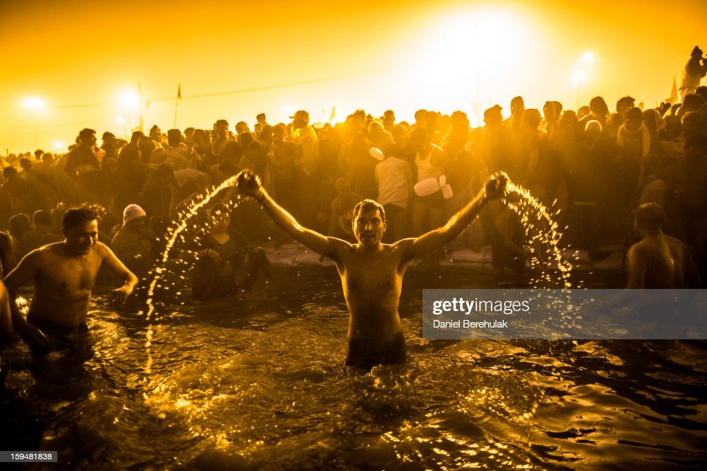 Hindu devotees bathe in the waters of the holy Ganges river during the auspicious royal bathing day of Makar Sankranti, the start of the Maha Kumbh Mela on January 14, 2013 in Allahabad, India. The Maha Kumbh Mela, believed to be the largest religious gathering on earth is held every 12 years on the banks of Sangam, the confluence of the holy rivers Ganga, Yamuna and the mythical Saraswati. The Kumbh Mela alternates between the cities of Nasik, Allahabad, Ujjain and Haridwar every three years. The Maha Kumbh Mela celebrated at the holy site of Sangam in Allahabad, is the largest and holiest, celebrated over 55 days, it is expected to attract over 100 million people.