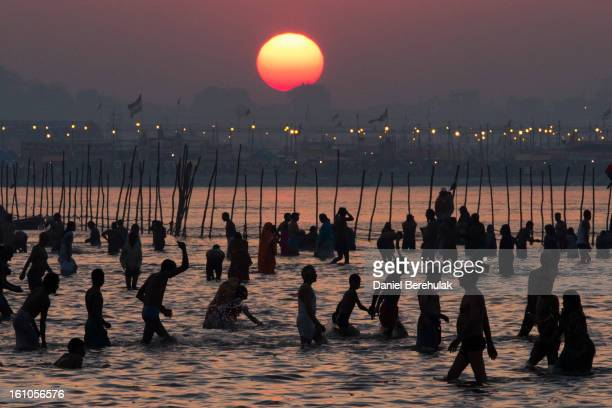 Hindu devotees bathe on the banks of Sangam the confluence of the holy rivers Ganges Yamuna and the mythical Saraswati during the Maha Kumbh Mela on...