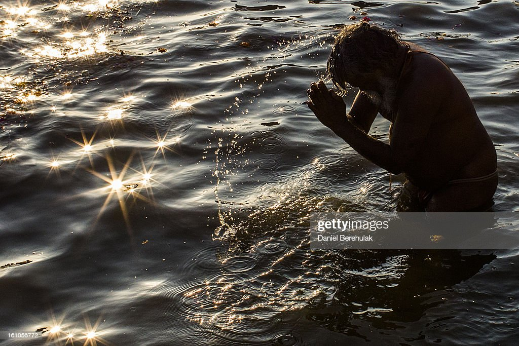 Hindu devotees bathe on the banks of Sangam, the confluence of the holy rivers Ganges, Yamuna and the mythical Saraswati, during the Maha Kumbh Mela on February 9, 2013 in Allahabad, India. The Maha Kumbh Mela, believed to be the largest religious gathering on earth, is held every 12 years on the banks of Sangam, the confluence of the holy rivers Ganga, Yamuna and the mythical Saraswati. The Kumbh Mela alternates between the cities of Nasik, Allahabad, Ujjain and Haridwar every three years. The Maha Kumbh Mela celebrated at the holy site of Sangam in Allahabad, is the largest and holiest, celebrated over 55 days, and is expected to attract over 100 million people.