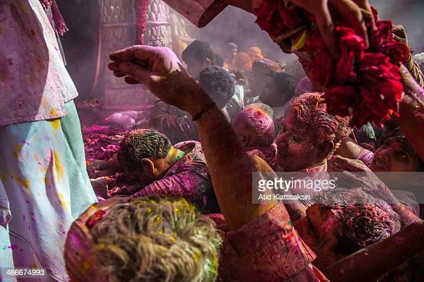 Hindu devotees celebrate the Holi festival in the Banke Bihari temple Known as the festival of colours Holi is an ancient Hindu festival celebrated...