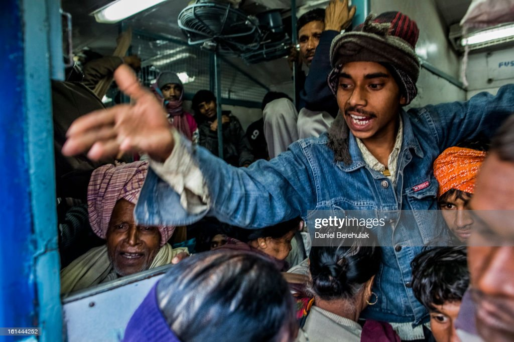 Hindu devotees cram into a train at Allahabad train station, the site of last night's stampede, during the Maha Kumbh Mela on February 11, 2013 in Allahabad, India. According to a government sources report, at least 36 people died in a stampede on a stair case as a train was pulling up on the busiest day of the Maha Kumbh Mela, . The Maha Kumbh Mela, believed to be the largest religious gathering on earth, is held every 12 years on the banks of Sangam, the confluence of the holy rivers Ganga, Yamuna and the mythical Saraswati. The Kumbh Mela alternates between the cities of Nasik, Allahabad, Ujjain and Haridwar every three years. The Maha Kumbh Mela celebrated at the holy site of Sangam in Allahabad, is the largest and holiest, celebrated over 55 days, and is expected to attract over 100 million people.