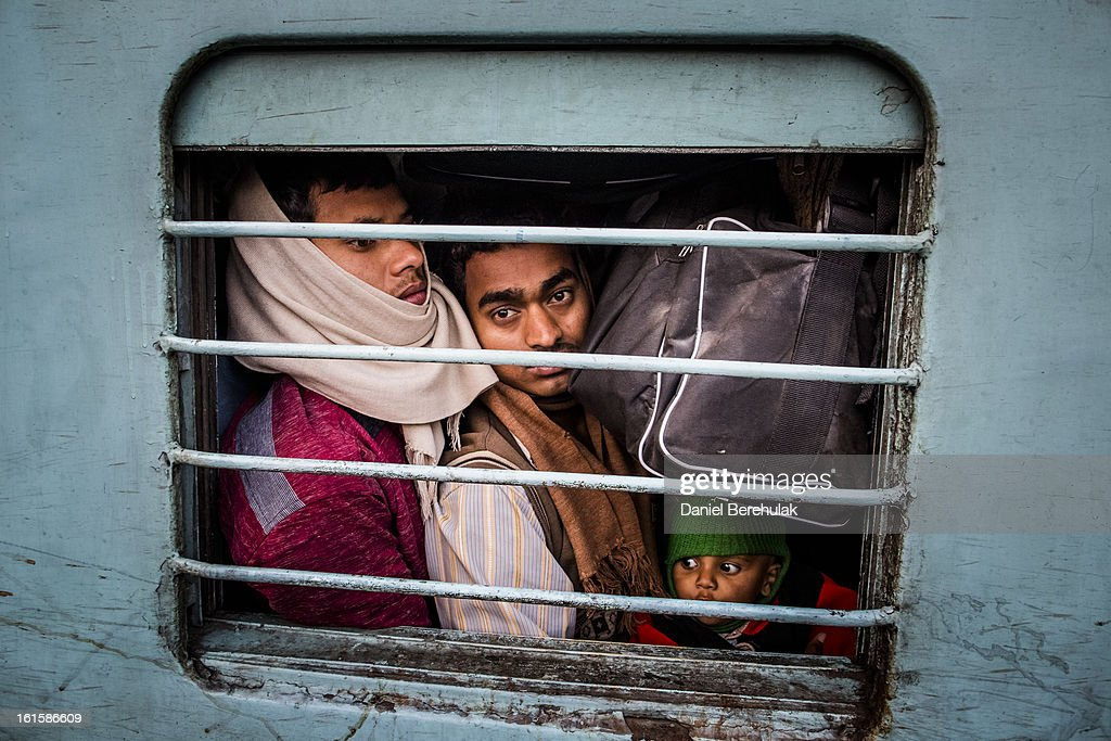 Hindu devotees cram onto their train at Allahabad train station, the site of last night's stampede, during the Maha Kumbh Mela on February 11, 2013 in Allahabad, India. According to a government sources report, at least 36 people died in a stampede on a stair case as a train was pulling up on the busiest day of the Maha Kumbh Mela, . The Maha Kumbh Mela, believed to be the largest religious gathering on earth, is held every 12 years on the banks of Sangam, the confluence of the holy rivers Ganga, Yamuna and the mythical Saraswati. The Kumbh Mela alternates between the cities of Nasik, Allahabad, Ujjain and Haridwar every three years. The Maha Kumbh Mela celebrated at the holy site of Sangam in Allahabad, is the largest and holiest, celebrated over 55 days, and is expected to attract over 100 million people.