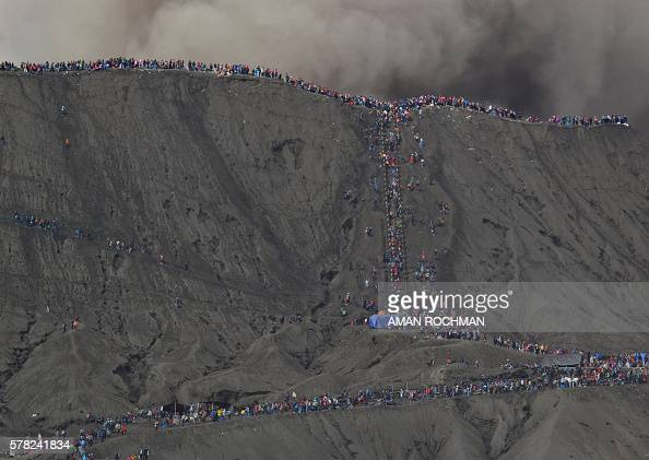 Hindu devotees from the Tengger tribe and tourists climb up to the crater of Mount Bromo during the Yadnya Kasada festival in Probolinggo on July 21...