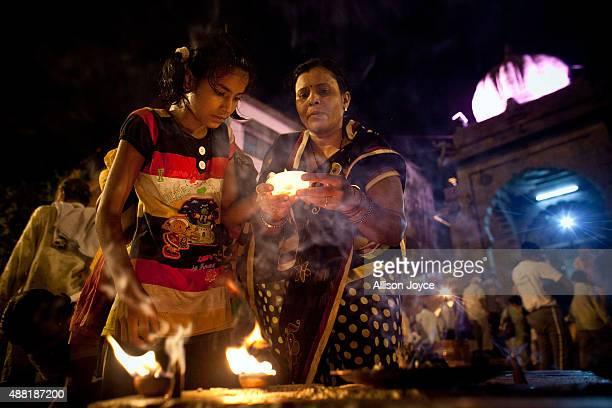 Hindu devotees gather before the second 'Shahi Snan' of Kumbh Mela in the Godavari river on September 12 2015 in Nashik India The Kumbh Mela one of...