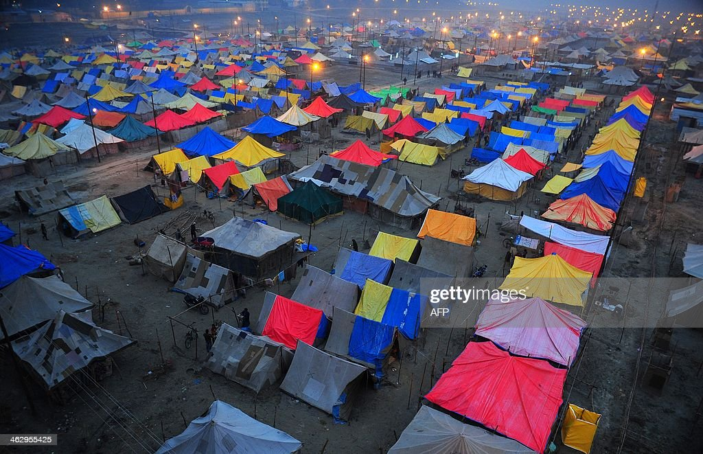 Hindu devotees go about their daily business at their tents pitched for the Magh Mela festival on the Ganga River in Allahabad on January 16 2014 The...