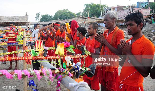 Hindu Devotees known as Kanwariya offer prayer before carried holy water from the River Ganges near the northern Indian city of Allahabad Kanwarias...