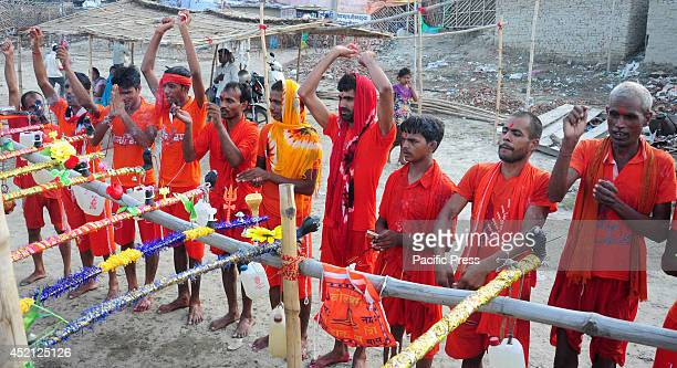 Hindu Devotees known as Kanwariya performing rituals before carried holy water from the River Ganges near the northern Indian city of Allahabad...
