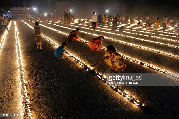 Hindu devotees light oil lamps as part of 'Laksha Deepotsava' held on the occasion of Makara Sanranti Festival in Bangalore on January 15 2016 Makar...