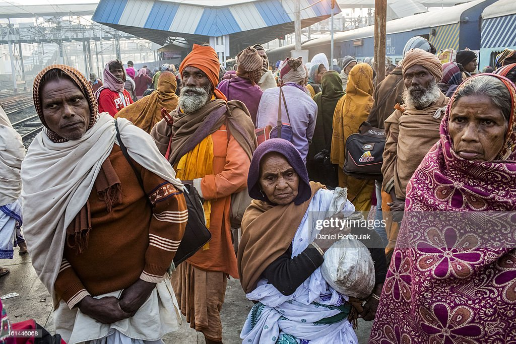 Hindu devotees move through Allahabad train station, the site of last night's stampede, during the Maha Kumbh Mela on February 11, 2013 in Allahabad, India. According to a government sources report, at least 36 people died in a stampede on a stair case as a train was pulling up on the busiest day of the Maha Kumbh Mela. The Maha Kumbh Mela, believed to be the largest religious gathering on earth, is held every 12 years on the banks of Sangam, the confluence of the holy rivers Ganga, Yamuna and the mythical Saraswati. The Kumbh Mela alternates between the cities of Nasik, Allahabad, Ujjain and Haridwar every three years. The Maha Kumbh Mela celebrated at the holy site of Sangam in Allahabad, is the largest and holiest, celebrated over 55 days, and is expected to attract over 100 million people.