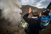Hindu devotees of the Tengger tribe pray during the Yadnya Kasada festival on the crater of Mount Bromo in Probolinggo on July 21 2016 During the...