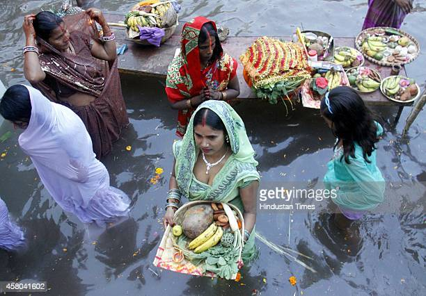Hindu devotees offer prayers to the Sun during the Chhath Festival on October 29 2014 in Gurgaon India Chhath puja is a major festival of Bihar which...
