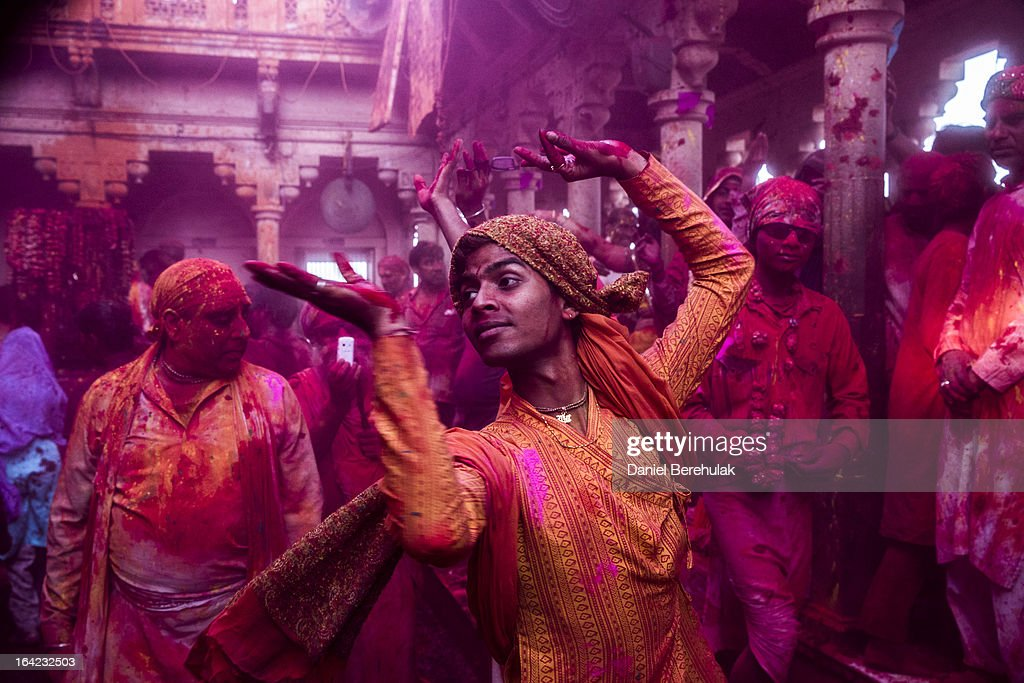 Hindu devotees play with color during Lathmaar Holi celebrations on March 21, 2013 in the village of Barsana, near Mathura, India. The tradition of playing with colours on Holi draws its roots from a legend of Radha and the Hindu God Krishna. It is believed that young Krishna was jealous of Radha's fair complexion since he himself was himself very dark. After questioning his mother Yashoda on the darkness of his complexion, Yashoda, teasingly asked him to colour Radha's face in which ever colour he wanted. In a mischievous mood, Krishna applied colour on Radha's face. The tradition of applying color on one's beloved is being religiously followed till date.