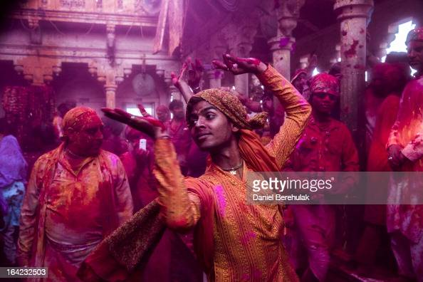 Hindu devotees play with color during Lathmaar Holi celebrations on March 21 2013 in the village of Barsana near Mathura India The tradition of...