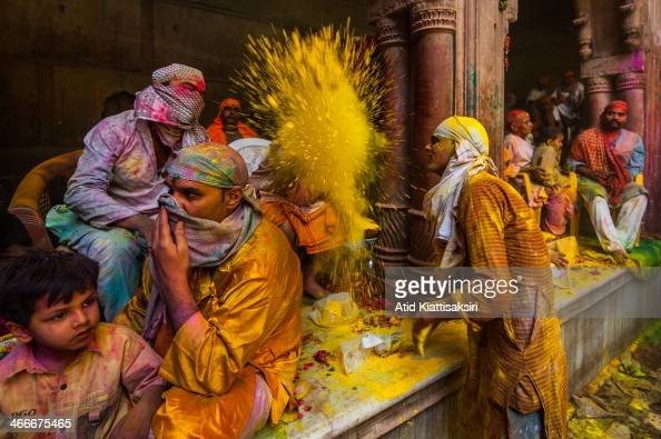 Hindu devotees play with colored powder during Holi festival at the Banke Bihari temple Known as the festival of colours Holi is an ancient Hindu...