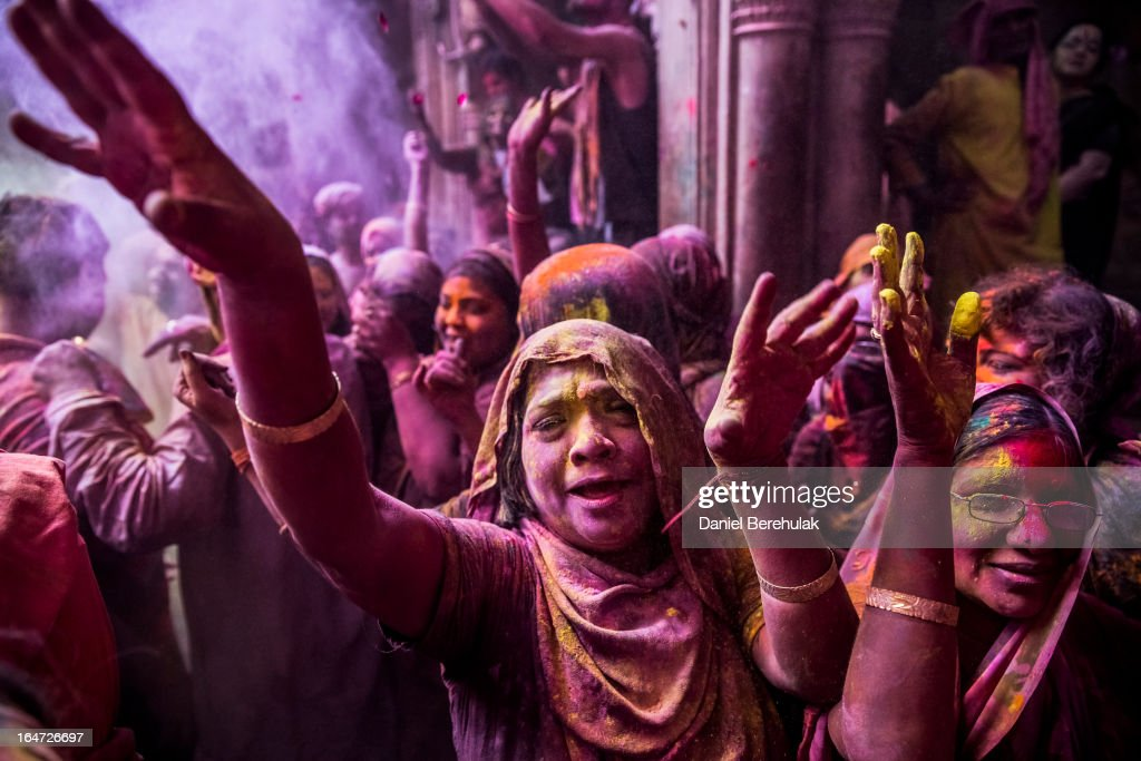 Hindu devotees play with colour during Holi celebrations at the Banke Bihari temple on March 27, 2013 in Vrindavan, India. The tradition of playing with colours on Holi draws its roots from a legend of Radha and the Hindu God Krishna. It is believed that young Krishna was jealous of Radha's fair complexion since he himself was very dark. After questioning his mother Yashoda on the darkness of his complexion, Yashoda, teasingly asked him to colour Radha's face in which ever colour he wanted. In a mischievous mood, Krishna applied colour on Radha's face. The tradition of applying color on one's beloved is being religiously followed till date.