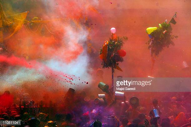 Hindu devotees play with coloured powders during Holi celebrations at the Bankey Bihari Temple on March 21 2011 in Vrindavan India Holi the spring...