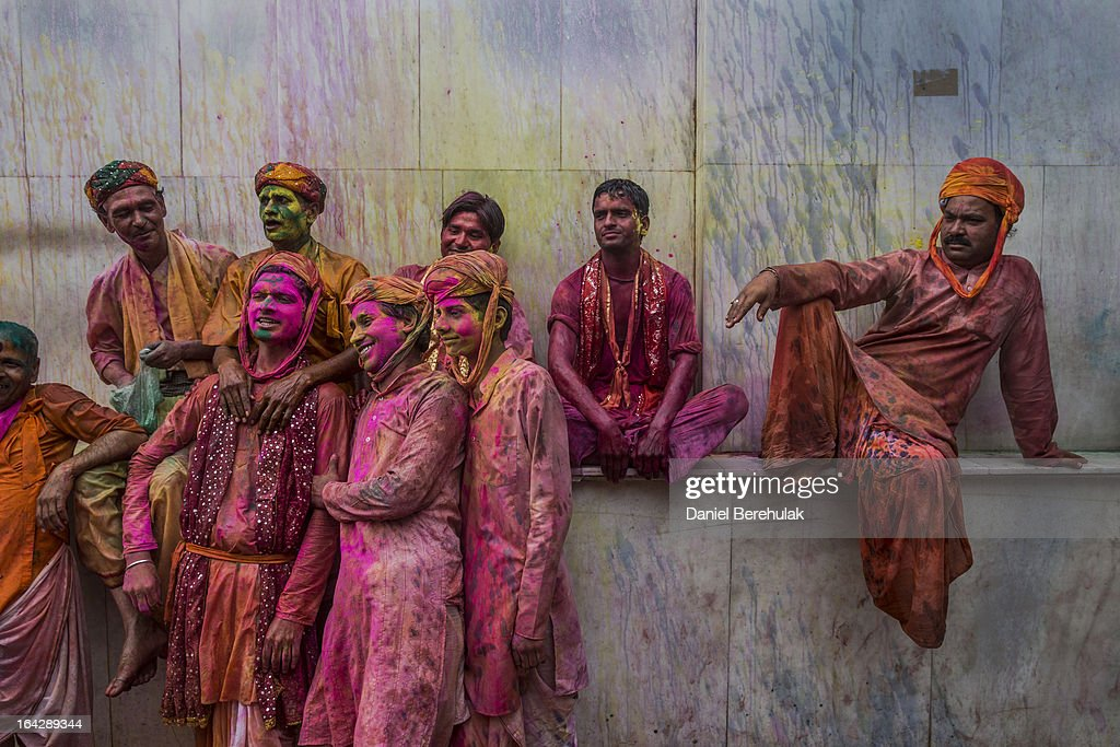 Hindu devotees rest during Lathmaar Holi celebrations on March 22, 2013 in the village of Nundgaon near Mathura, India. The tradition of playing with colours on Holi draws its roots from a legend of Radha and the Hindu God Krishna. It is believed that young Krishna was jealous of Radha's fair complexion since he himself was himself very dark. After questioning his mother Yashoda on the darkness of his complexion, Yashoda, teasingly asked him to color Radha's face in which ever color he wanted. In a mischievous mood, Krishna applied color on Radha's face. The tradition of applying color on one's beloved is being religiously followed until today.