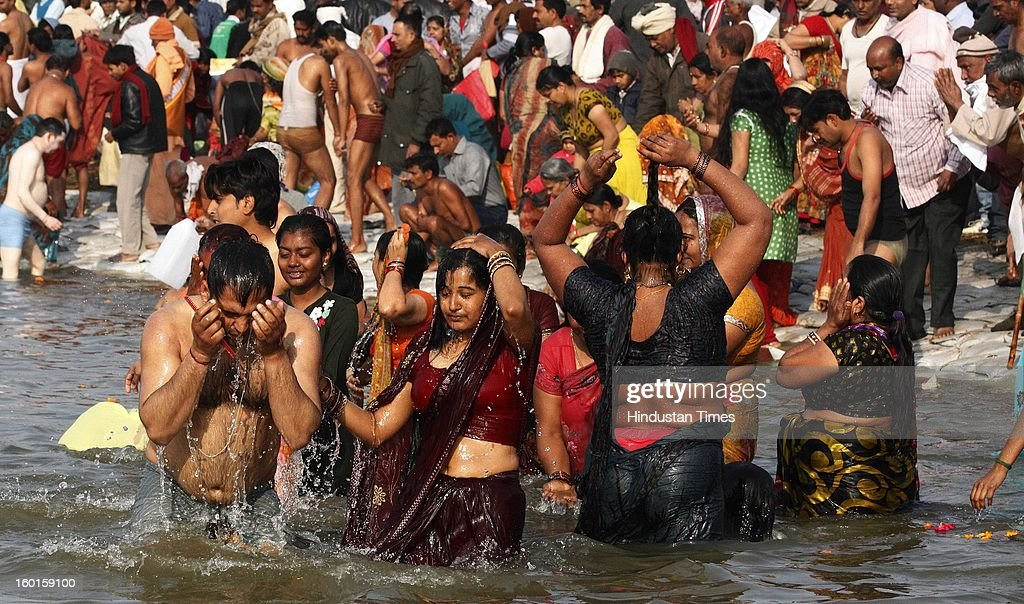 Hindu devotees take a holy dip at the Sangam, confluence of rivers Ganga, Yamuna and mythical Saraswati on the occasion of Paush Purnima on January 27, 2013 in Allahabad, India. Millions of Hindu pilgrims are expected to take part in the large religious congregation of a period of over a month on the banks of Sangam during the Maha Kumbh Mela in January 2013, which falls every 12th year.