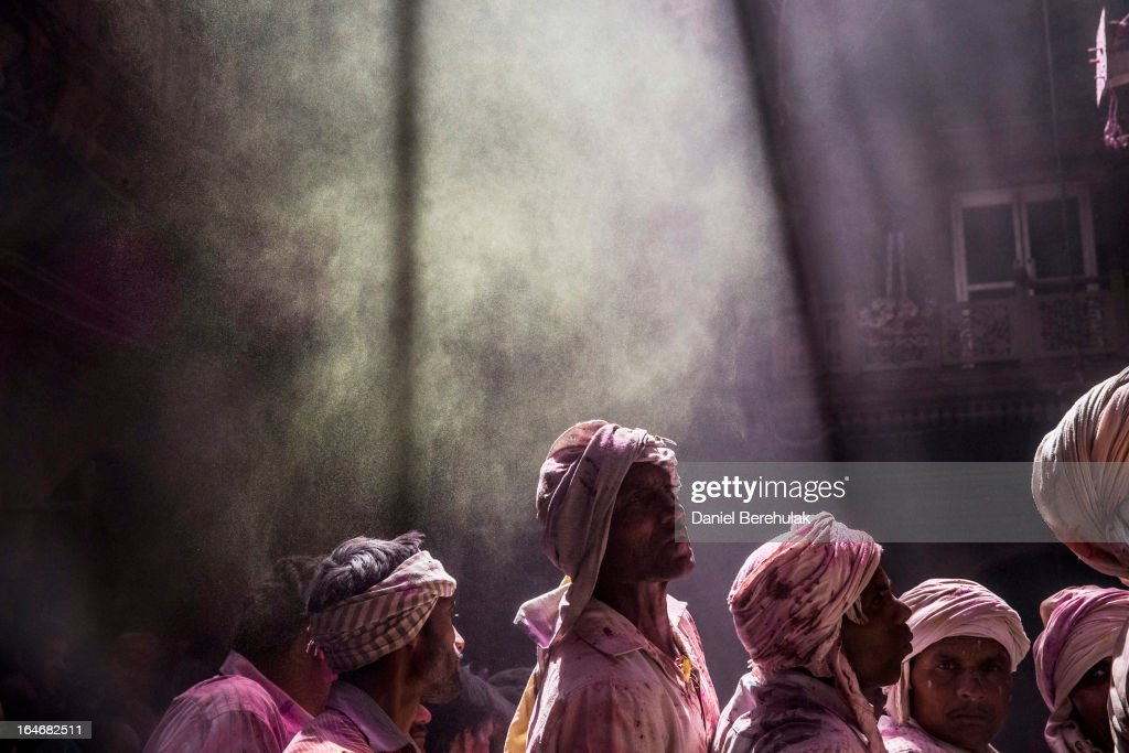 Hindu devotees wait for a statue of Lord Krishna to be revealed during Holi at the Banke Bihari temple on March 26, 2013 in Vrindavan, India. The tradition of playing with colors on Holi draws its roots from a legend of Radha and the Hindu God Krishna. It is believed that young Krishna was jealous of Radha's fair complexion since he himself was very dark. After questioning his mother Yashoda on the darkness of his complexion, Yashoda, teasingly asked him to colour Radha's face in which ever colour he wanted. In a mischievous mood, Krishna applied colour on Radha's face. The tradition of applying color on one's beloved is being religiously followed till date.
