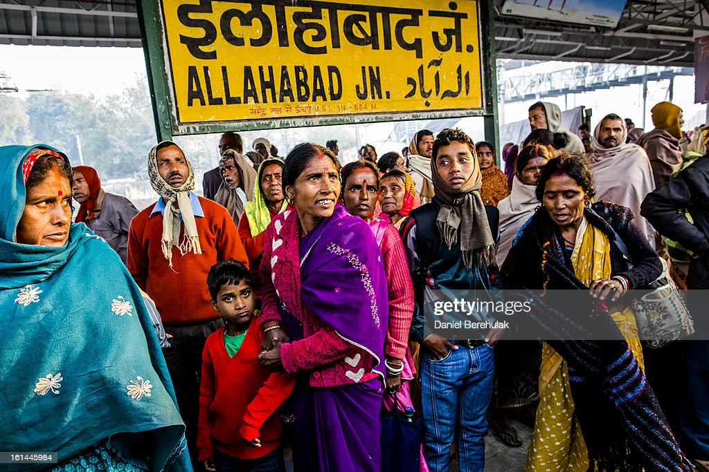 Hindu devotees wait for their train at Allahabad train station, the site of last night's stampede, during the Maha Kumbh Mela on February 11, 2013 in Allahabad, India. According to a government sources report, at least 36 people died in a stampede on a stair case as a train was pulling up on the busiest day of the Maha Kumbh Mela. The Maha Kumbh Mela, believed to be the largest religious gathering on earth, is held every 12 years on the banks of Sangam, the confluence of the holy rivers Ganga, Yamuna and the mythical Saraswati. The Kumbh Mela alternates between the cities of Nasik, Allahabad, Ujjain and Haridwar every three years. The Maha Kumbh Mela celebrated at the holy site of Sangam in Allahabad, is the largest and holiest, celebrated over 55 days, and is expected to attract over 100 million people.