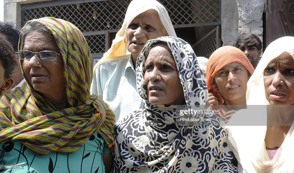 Hindu families who have taken shelter at Shiv Temple in Palvi village during communal clashes on September 10, 2013 in Muzaffarnagar, India. No untoward incident was reported from Muzaffarnagar today as 975 people were arrested for their direct or indirect role in the communal violence that has left 35 dead.