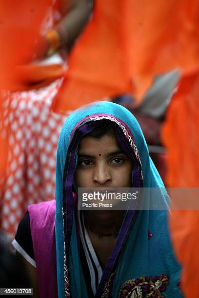 Hindu Girl listens to the spiritual leaders speech during a protest against 'Love Jihad' at New Delhi Love Jihad is an alleged activity under which...