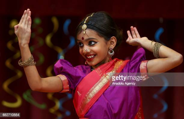 Hindu girl performs during the Holi Festival celebrations at Hindu temple in Lemont district Chicago United States on March 12 2017 Holi the festival...