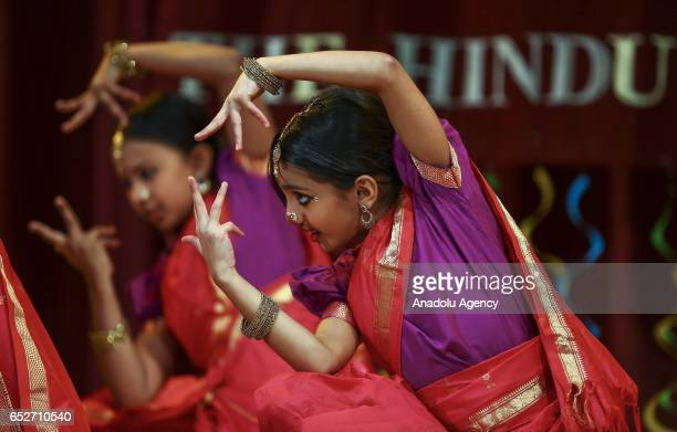 Hindu girls perform during the Holi Festival celebrations at Hindu temple in Lemont district Chicago United States on March 12 2017 Holi the festival...