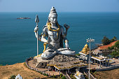 Hindu god statue, lord Shiva sculpture sitting in meditation India