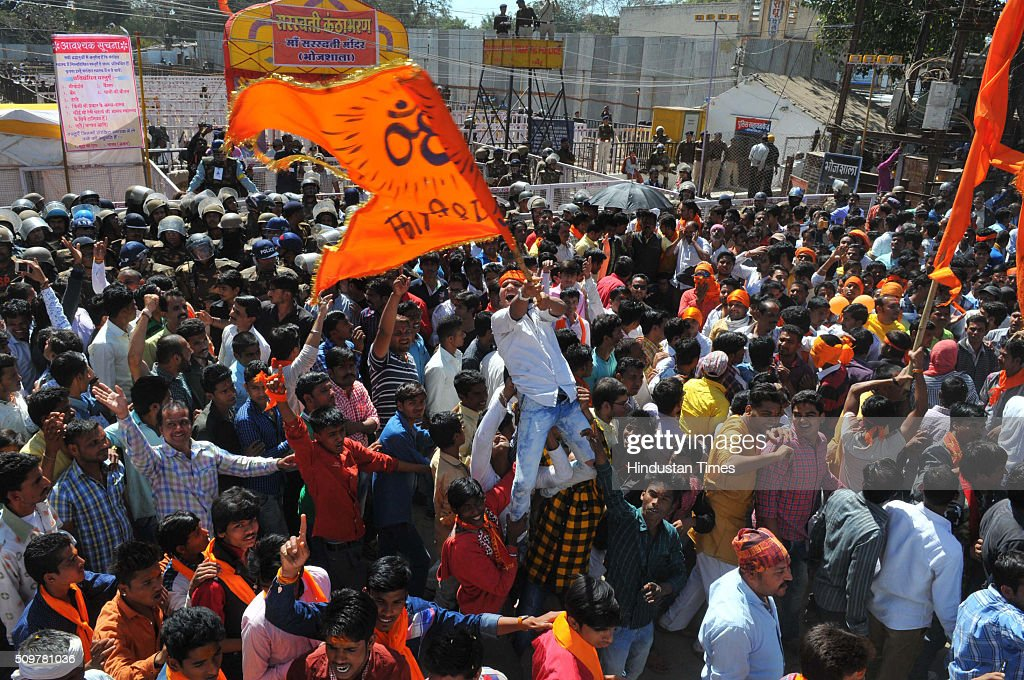 Hindu harliners protesting outisde the Bhojshala temple on February 12, 2016 in Dhar, India.The contested site is the Kamal-al-Din congregational mosque of Dhar also known as Bhojshala is protected by the Archaeological Survey of India, which allows Muslims to offer jummah or Friday prayers. Hindus are allowed entry in the monument to offer prayers on Tuesdays and conduct a special puja on the occasion of Basant Panchami. This week, however, the Friday prayers coincide with the festival of Basant Panchami.