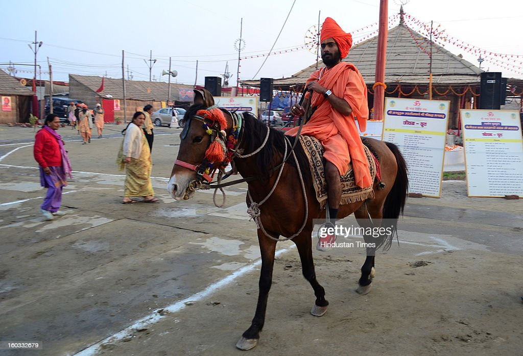 A Hindu holy man enjoy horse riding at Bada Udaseen Akhara, in a Kumbh Mela area, on January 29, 2013 in Allahabad, India. Millions of Hindu devotees have begun their month-long kalpvas at the tent city set up over 58 square kilometers and divided into 14 sectors inter-connected using 17 pontoon bridges.