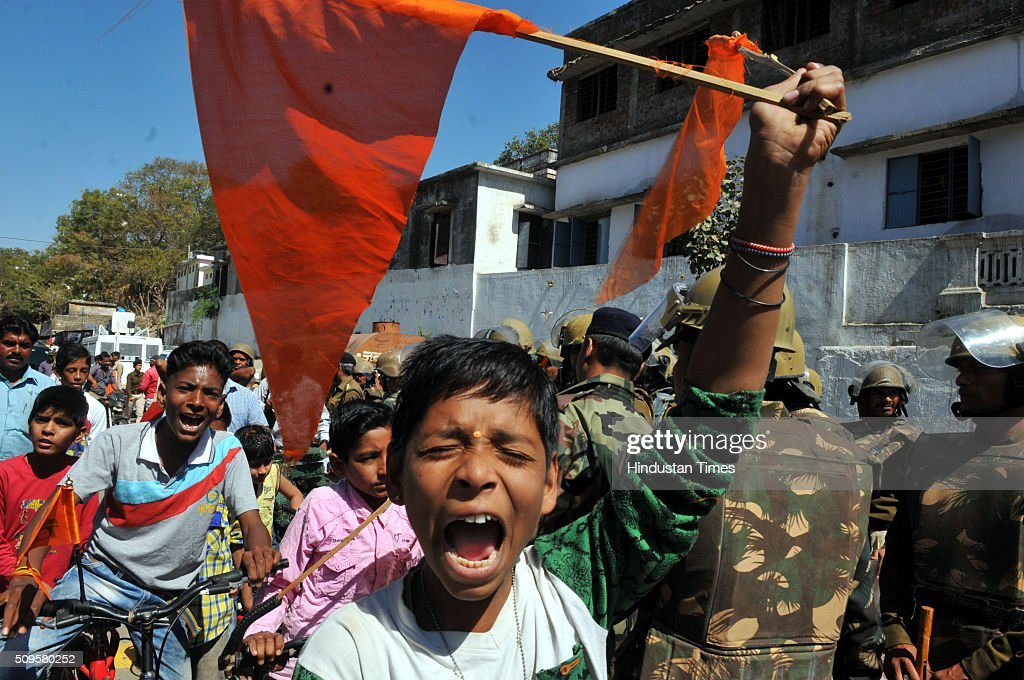 A Hindu kid raise a flag as he shout slogan demanding for Bhojshala on February 11, 2016 in Dhar, India. A communal flare-up is feared in the otherwise peaceful town of Dhar, Madhya Pradesh, on Friday, February 12. The contested site is the Kamal-al-Din congregational mosque also called Bhojshala is protected by the Archaeolgical Survey of India, which allows Muslims to offer jummah or Friday prayers. Hindus are allowed entry in the monument to offer prayers on Tuesdays and conduct a special puja on the occasion of Basant Panchami. This week, however, the Friday prayers coincide with the festival of Basant Panchami.