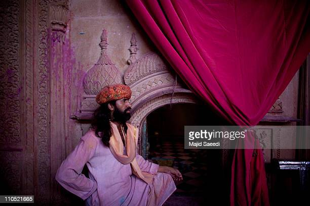 Hindu man stands by a door of the Bankey Bihari Temple during Holi celebrations on March 21 2011 in Vrindavan India Holi the spring festival of...