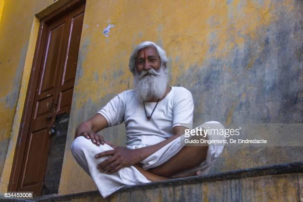Hindu man with white beard and red tika in Pushkar, Rajasthan, India