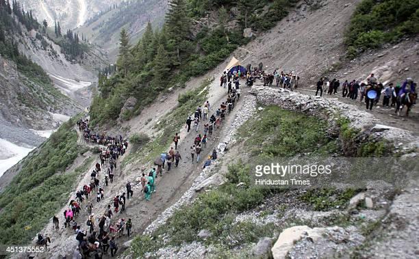 Hindu pilgrims on a hill on their way to the Amarnath cave on June 28 2014 near Railpathri 125 kilometers northeast of Srinagar India The annual...