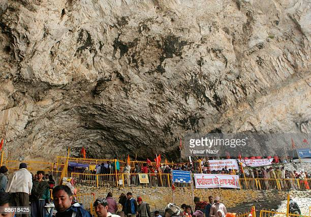 Hindu pilgrims queue to see an ice stalagmite resembling Shiva outside the sacred cave of Amarnath one of the most revered of Hindu shrines on June...