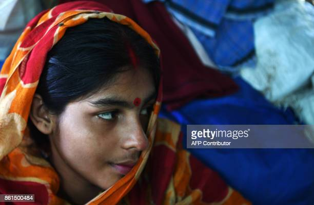 A Hindu refugee from Rakhine state looks on inside her makeshift hut at the Kutupalong Hindu refugee camp in the Bangladeshi district of Ukhia on...