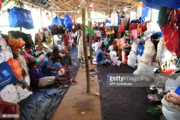 Hindu Rohingya refugees are seen inside a community living area at the Kutupalong Hindu refugee camp in Ukhia district on October 15 2017...